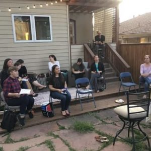 Members of the Denver Family Institute alumni group meet in a backyard