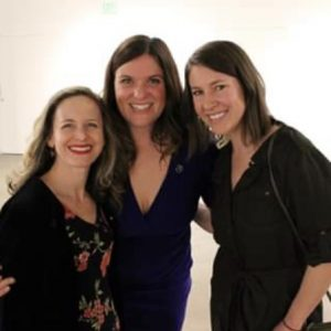 Three members of the Denver Family Institute pose at an event